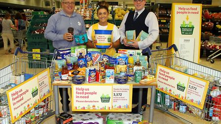 Mark Dowell, Louisa Littlewood and Duncan Sheridan-Shaw from Honiton Tesco have been taking donation
