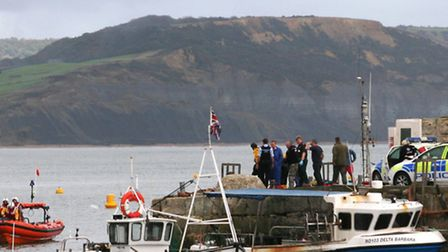 Rescuers on the harbour wall after wheelchair girl Claire plunges off the side