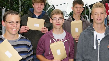 Axe Valley Community College students with their GCSE results (l tor) Steven Apsey, Charlie Hall, Br