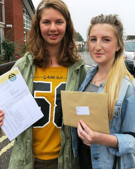 Axe Valley Community College students with their GCSE results (l tor) Hannah Burnett, from Stockland