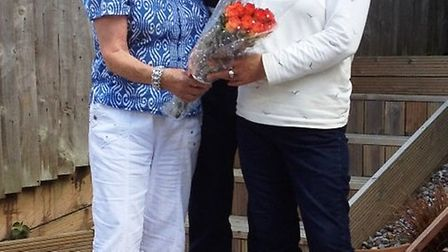 Denise Bartlett welcomes flood victims Chris and Jackie to Lyme Regis on behalf of the Rotary Club,