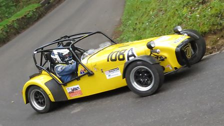 Sports cars provide good entertainment at Wiscombe Park. Here a Caterham Sven rounds the challenging