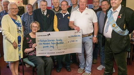 Beer Buffs present the cheque to the MS Society