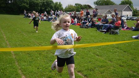 An Offwell pupil crosses the finish line.