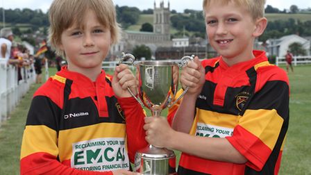 Honiton RFC eight year olds Eiran Enticott and Harry Branch pose with the David Turner Memorial Cup