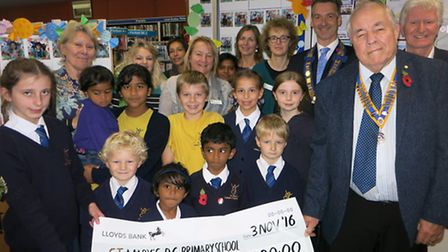 St Mary's reading challenge champions collect their £100 prize from Axminster Rotary Club president