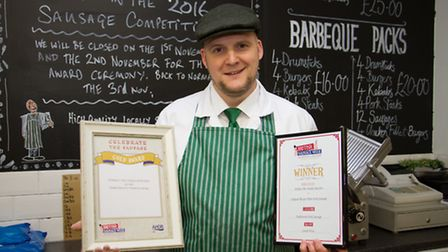 Laurie with his certificates at Porkies butchers in New Street. Ref mhh 44-16TI 1337. Picture: Terry