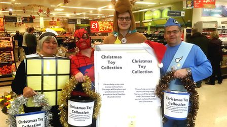 Axminster Tesco's' super heoroes' - raising money to buy Christmas toys for local children. Picture