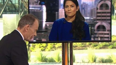 Priti Patel appears to smirk during a discussion about business fears. Photograph: BBC.