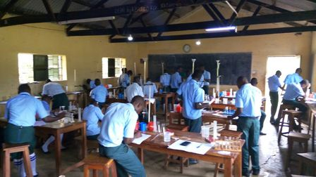 UCE ('O' Level) students doing a chemistry practical. Picture courtesy of Richard Lucas