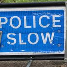 ndg-police-slow-sign