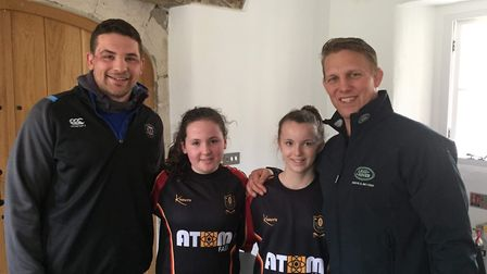 Chard Under-15 girls' Amber Coombes and Georgia Smillie together with Bath RFC lock Charlie Ewels an