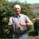 Octogenarian Sid Pember with trophy and Rolex watch after his hole-in-one at Axe Cliff