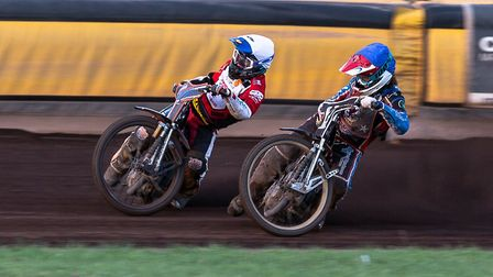 Somerset Rebels rider Richard Lawson (left) battles it out with Rohan Tungate of Swindon Robins. Pic
