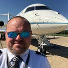 Stuart Morton with the Global Express XRS Plane that I fly after landing in Stansted. Picture: Stuar