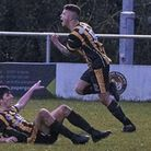 Axminster Towns Nathan Antat after scoring at Bovey Tracey with team mate Tony Pinder. Picture SARAH