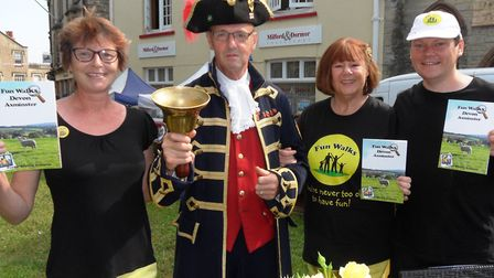 Axminster Town Crier Nick Goodwin proclaimed the launch of a new series of fun walks books.pictured