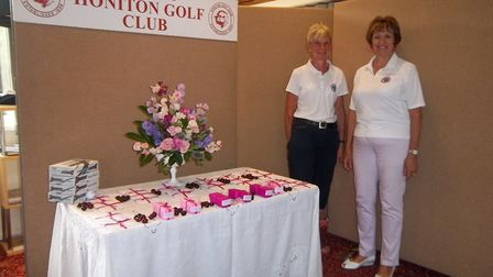The Honiton Ladies' Open prize table with Stephi Barnes and ladies' captain Cherry Liell. Picture: H
