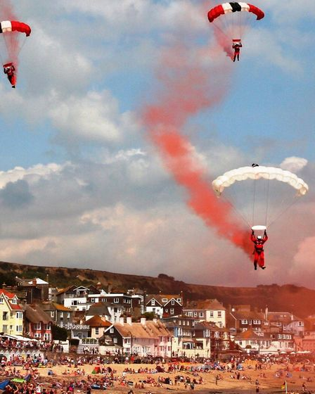 The Red Devils coming in to land on the Cobb sands at Lyme Regis. Picture Richard Horobin