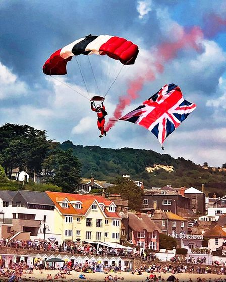 A Red Devil flies the flag as he lands on Lyme beach. Picture Andy Butterfield