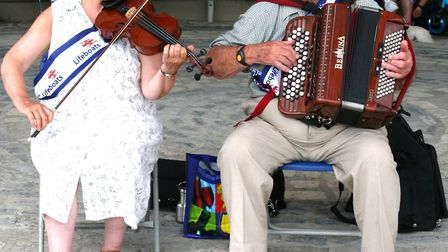 Friends Holly Chapman. 70, and Ivor Hyde, 92, have been busking at Lyme lifeboat week for the past 2