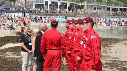 Lyme mayor Brian Larcombe greets the Red Devils after their landing on Cobb beach. Picture Richard H