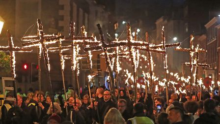 Participants parade through the town of Lewes in East Sussex during an annual bonfire night processi