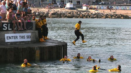 The lifeboat tug of war team ends up in the water. Picture Richard Horobin