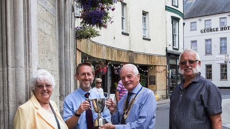 Rotary club president Don Waterhouse presents pharmacist Ian Morton with the trophy for the best han