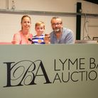 Simon and Susie Watson with their son Max at Lyme Bay Auctions. Ref edr 31 19TI 9214. Picture: Terry