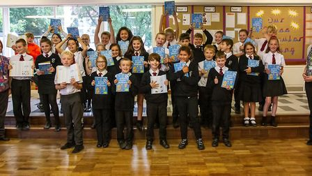 Pupils at Axminster Community Primary Academy, with year head Heidi Wickens, receiving their Usborne