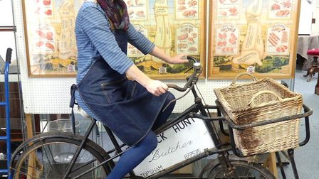 Liz Chilcott shows off the butchers bike going under the hammer in Honiton. Picture: Sue Cade