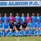 The Beer Albion senior players with some of the clubs juniors at the club's Centenary Celebration ma