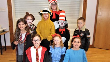 Chardstock pupils dressed as characters from their favourite story books with school administrator N