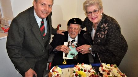 Joe Daniels is presented with his 108th birthday card from The Queen by the Deputy Lord Lieutenant