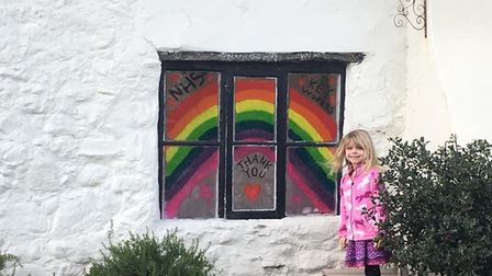 Izzy, six, from Seaton, with the rainbow she made Picture: Steven Downer