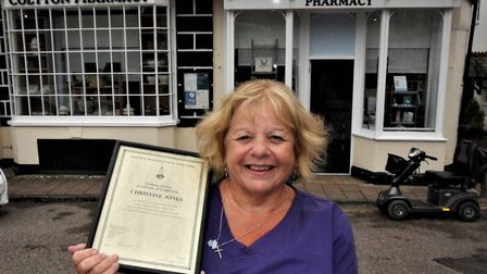 Christine Jones with her training certificate outside Colyton Pharmacy where she has worked for som