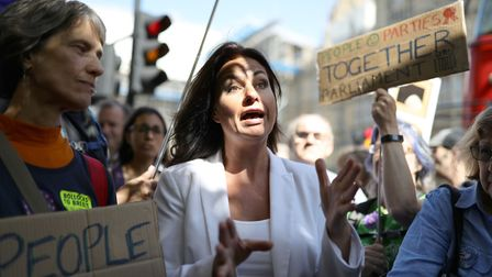 Heidi Allen speaks to Brexit protesters outside the Houses of Parliament in Westminster, London. Pho