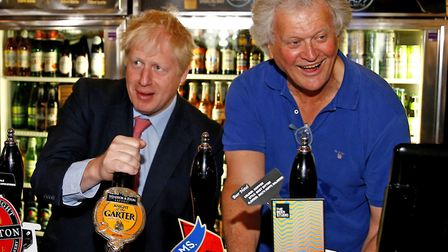 Tim Martin, Chairman of JD Wetherspoon with Prime Minister Boris Johnson during a visit to Wetherspo