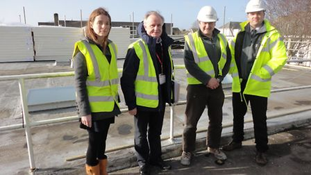 Pictured on the Braunton Academy roof are Kay Tregenna and John Thorn from TFQ Architects plus Marcu