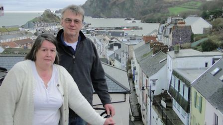 Christine and Paul Tew on their fourth floor balcony overlooking Fore Street in Ilfracombe.