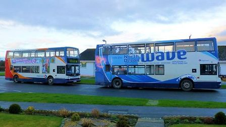 Michael Screech photographed the buses outside his house.