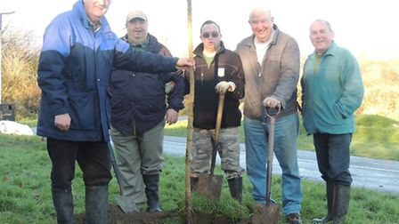 Pictured at the Newport tree planting are Councillor John Mathews, volunteers Chris Pike and Craig N