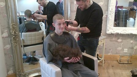 Tristan had his head shaved by salon owner Steven Bishop on Saturday.