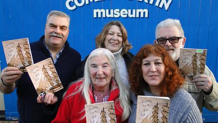 Some of the Sail Loft Scribblers with the new book they have put together to raise money for the mus