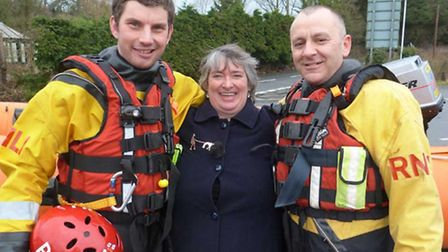 Vanessa Glover pictured with her saviours Chris Missen and Paul Eastment of the RNLI Flood Rescue Te