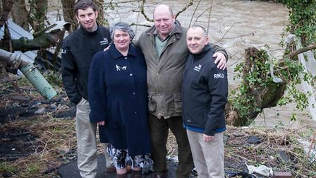Vanessa and Paul Glover on the bank of the Taw with Flood Rescue Team members Chris Missen and Paul