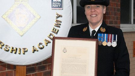 Master-at-Arms Lorraine Perrin is pictured with her award at HMS Collingwood.