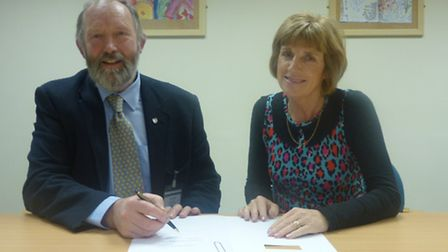 Chairman of governors Jeremy Yabsley and principal Jenny Glover prepare the documentation for the ch
