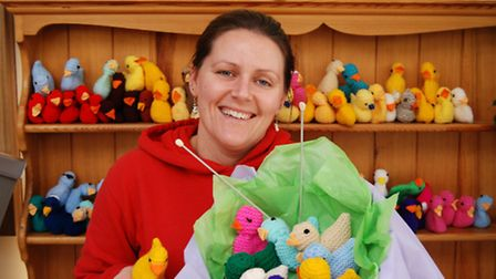 Rebecca Worth is pictured with dozens of chicks knitted by the Knit and Natter group from Combe Mart